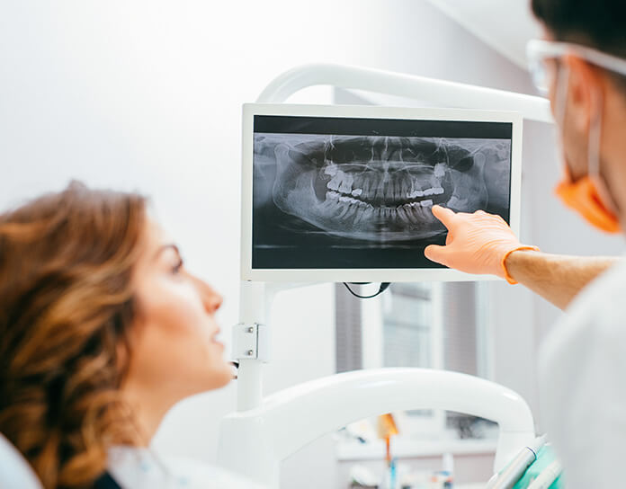 dentist telling a patient about her x-rays