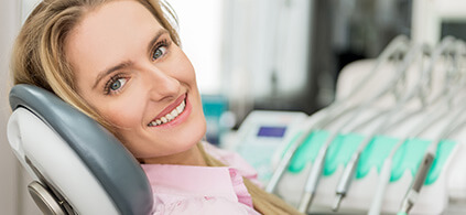 smiling woman sitting in a dental chair