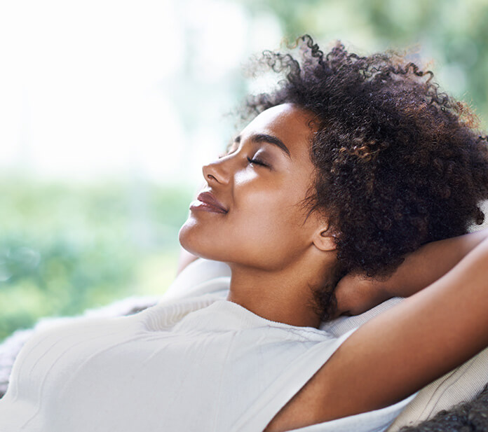woman laid back and relaxing with her eyes closed